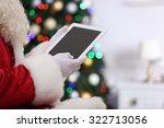 Santa Holding Tablet On...