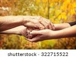 Autumn. Hands Of An Elderly...
