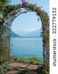an arched garden arbor in... | Shutterstock . vector #322779152