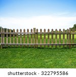 Wooden Fence On Grass In Front...