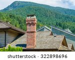 Chimney And Pipe On The Roof O...