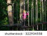 girl climbing in adventure rope ... | Shutterstock . vector #322934558