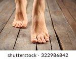 female feet on wooden background | Shutterstock . vector #322986842