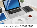 modern workplace with laptop ... | Shutterstock . vector #323022788