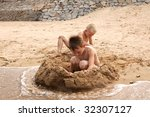 two brothers building sand... | Shutterstock . vector #32307127