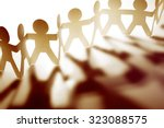 team of paper doll people | Shutterstock . vector #323088575