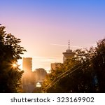 Stock photo downtown vancouver behind the trees at sunset 323169902
