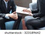 businessman and businesswoman... | Shutterstock . vector #323189642