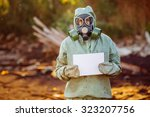Man With Gas Mask And Green...