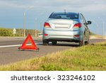 broken car with red triangle... | Shutterstock . vector #323246102