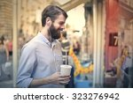 happy man holding a soft drink | Shutterstock . vector #323276942