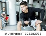 young handsome man training in... | Shutterstock . vector #323283038
