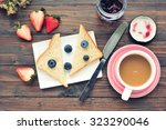 bread with coffee on wood table....   Shutterstock . vector #323290046