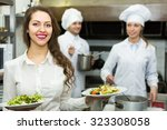 two chefs and young female... | Shutterstock . vector #323308058