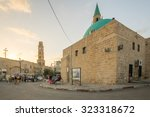 Small photo of ACRE, ISRAEL - OCTOBER 01, 2015: Street scene with Sinan Basha Mosque (alBahr Mosque), the clock tower, locals and visitors, in the old city of Acre, Israel
