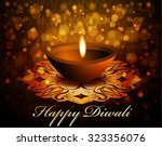 happy diwali greeting card... | Shutterstock .eps vector #323356076