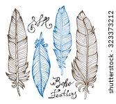hand drawn bird feathers... | Shutterstock .eps vector #323373212