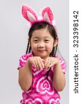 little girl with bunny ears ... | Shutterstock . vector #323398142