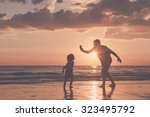 father and son playing on the... | Shutterstock . vector #323495792