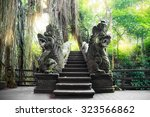 stutue in sacred monkey forest  ... | Shutterstock . vector #323566862
