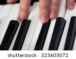 piano playing  close up on... | Shutterstock . vector #323603072