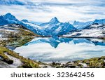 swiss alps water reflection in  ...