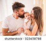 portrait of happy young parents ... | Shutterstock . vector #323658788