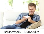 Man Playing Online Games With ...
