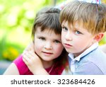 cute children are playing in... | Shutterstock . vector #323684426