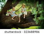 two cute little kids sitting on ... | Shutterstock . vector #323688986