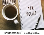 Small photo of Thinking on Tax Relief, personal finance conceptual