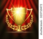 shining golden trophy cup with... | Shutterstock .eps vector #323710472