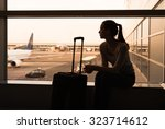 Female Traveler Waiting At The...