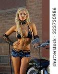 sexy motorcycle biker girl... | Shutterstock . vector #323730986