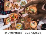 friends having dinner. top view ... | Shutterstock . vector #323732696