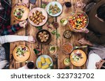 enjoying dinner together. top... | Shutterstock . vector #323732702