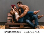 playful couple. playful young... | Shutterstock . vector #323733716