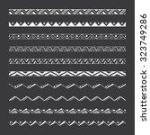 hand drawn vector borders ... | Shutterstock .eps vector #323749286