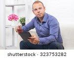 handsome businessman sitting on ... | Shutterstock . vector #323753282
