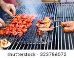 cook's hand grilling chicken on ... | Shutterstock . vector #323786072
