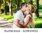 happy smiling couple in love | Shutterstock . vector #323814452