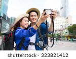 happy tourists taking photo of... | Shutterstock . vector #323821412