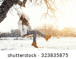 happy girl and rope swing at... | Shutterstock . vector #323835875