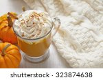 pumpkin latte with whipped... | Shutterstock . vector #323874638