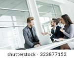 young people working in the... | Shutterstock . vector #323877152