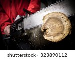 Man With Chainsaw Cutting The...
