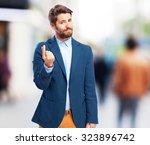 businessman money gesture   Shutterstock . vector #323896742