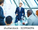 young businessman looking at... | Shutterstock . vector #323906096