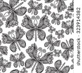 vector hand drawn butterflies.... | Shutterstock .eps vector #323914382