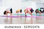 four girls practicing yoga ... | Shutterstock . vector #323922476